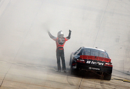 large_2008-dover-sept-nns-kyle-busch-celebrates-win-on-track1